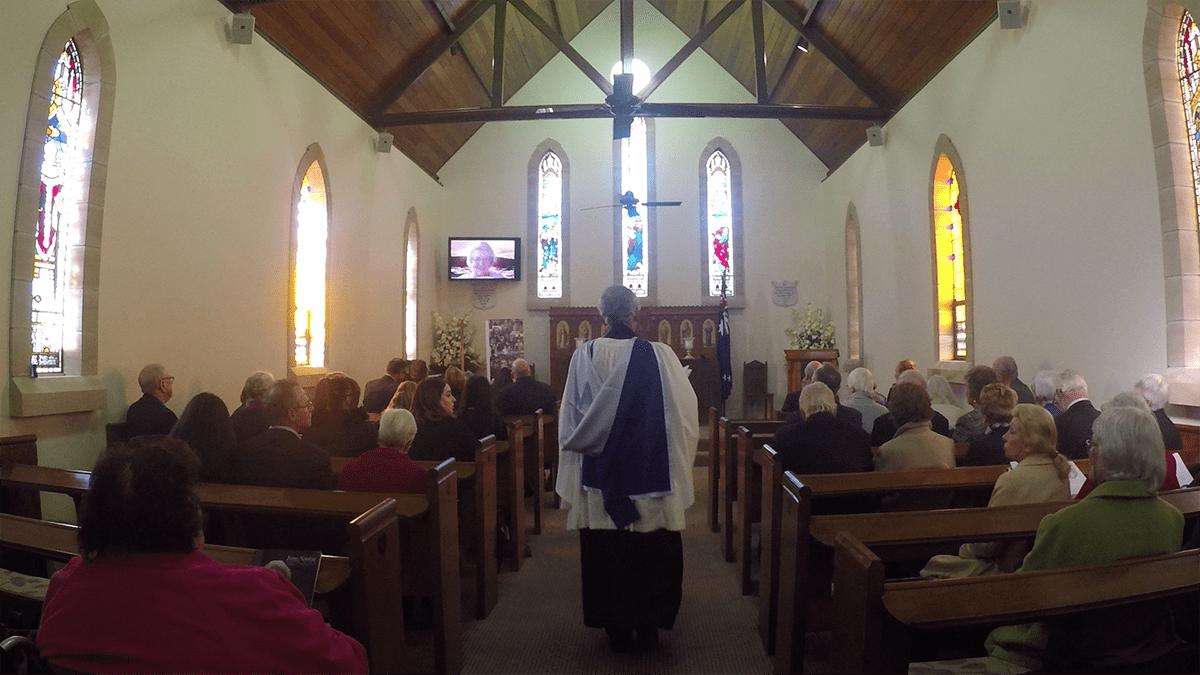 Reverend Peter Rose OAM entering the Memorial Service for Irene Simkin on June 2, 2017