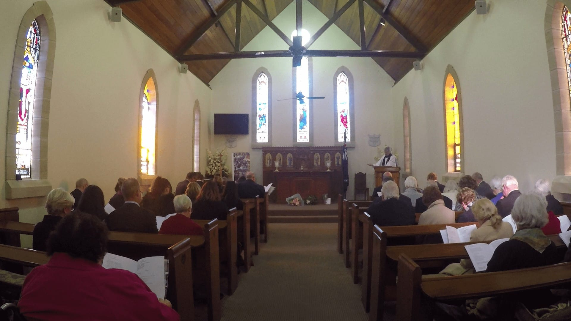 The Reverend Peter Rose, OAM, delivers the service with the commital of Irene's ashes at the Memorial for Irene Simkin on June 2, 2017