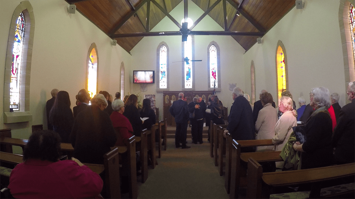 Mandy & Emma, Toby & Troy embrace at the beginning of the recessional at the Memorial Service for Irene Simkin on June 2, 2017